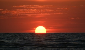 The sun fades away over the Gulf of Mexico as seen from Sanibel Island.
